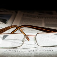 Glasses on newspaper. Natural lightings